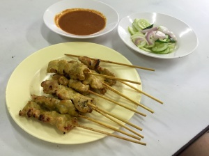 Chicken Satay (or prok--I think this was pork) is served with a savory peanut sauce with a kick for dipping as well as a refreshing cucumber/onion salad on the side.