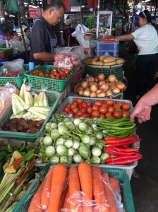 Fresh vegetables are used in meal preparation in almost every dish in Thailand and you can find just about everything you need in the market. Here is a small selection that includes lemongrass, carrots, severa types of eggplant and chilis, tomatoes, onions, and potatoes.