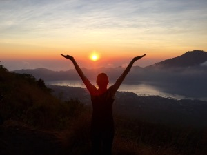 Celebrating the sunrise from the volcano, Mt. Batur, in Bali.